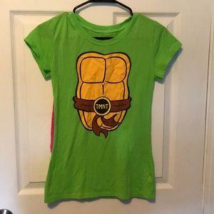 Teenage mutant ninja turtle shirt.